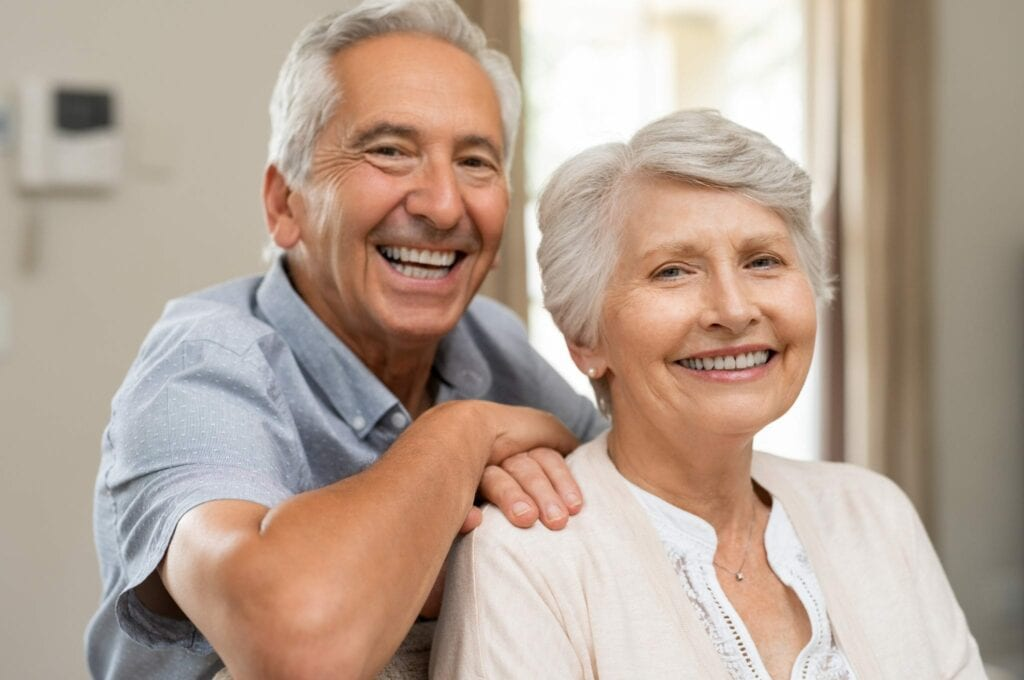 Happy senior couple smiling services idental group