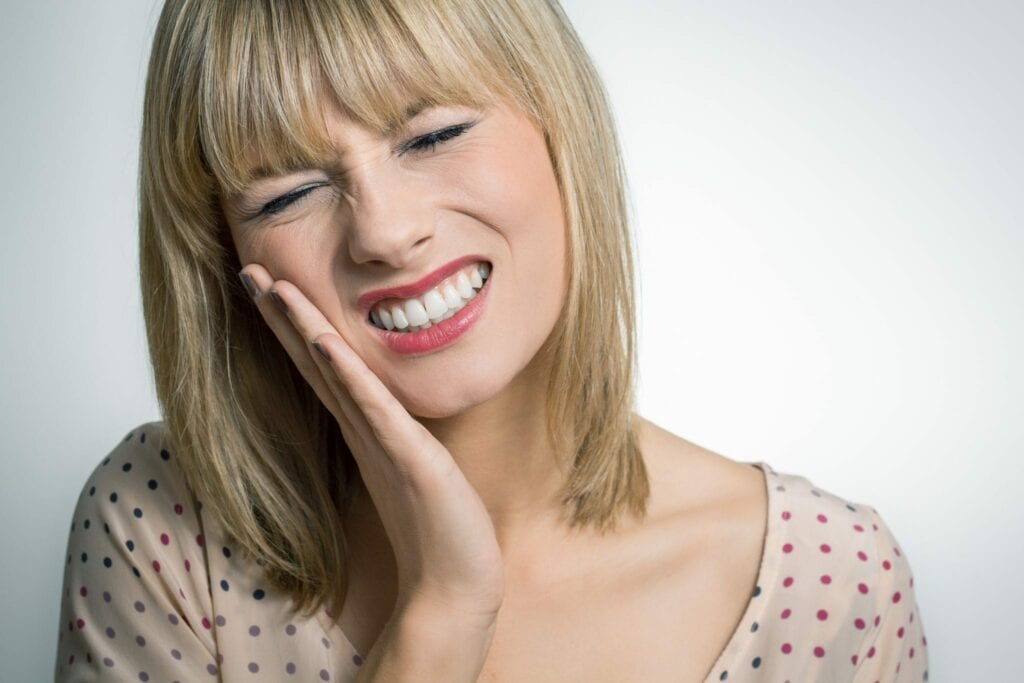 woman with a toothache services idental group
