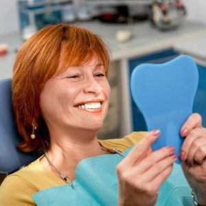 woman in the dental office. hybrid dental implants idental group